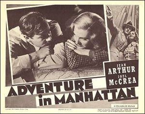 Adventure in Manhattan Jean Arthur Joel McCrea pictured looking at a model building on stage